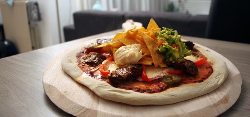 Met dit Mexicaanse Pizza recept verras je je gasten gegarandeerd!